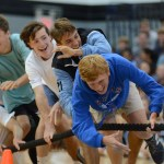 Senior soccer players Tommy Kerr, Oliver Bihuniak, Luke Ramey, and Taylor Stover are pulled over during the soccer vs football tug of war game. Photo by Ellen Swanson