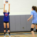 Freshman Brigid Wentz practices setting the ball in a partner drill. Photo by Ellen Swanson