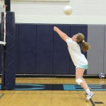 Sophomore Maggie Scott tries to hit the ball and misses. Photo by Ellen Swanson