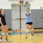 Freshman Paige Valentine practices hitting the ball at tryouts. Photo by Ellen Swanson