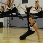 Sophomore Gia Hense kicks while the rest of the team does a toe touch. Photo by Ellen Swanson