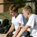 Juniors Bennett Meeds and Sam Thompson discuss strategies during tryouts. Photo by Sophie Storbeck