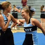 Senior and Varsity Cheerleader Mallory Gray jokes around with Sophomore and Jv Cheerleader Megan Packel before they perform their routine. Photo by Ellie Thoma