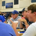 Juniors Matt Hogan, Will Benjamin and Joseph Brouilette chat over pancakes. Photo by Lizzie Kahle