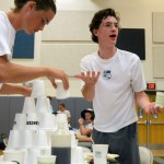 Seniors Clayton Phillips and Luke Ramey build a tower of cups. Photo by Lizzie Kahle