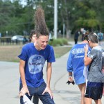 Freshman Henry Sowell flips his hair after being soaked at the Theater Car Wash. Photo by Katherine Odell
