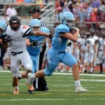 Junior Milton Braasch breaks through the line of scrimmage to go on and score a touchdown. Photo by Audrey Kesler