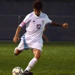 Senior Oliver Bihuniak plays the ball forward. Photo by Audrey Kesler