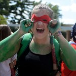Senior Stella Kirkman adjusts the mask of her Teenage Mutant Ninja Turtle costume. Photo by Haley Bell