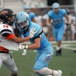 Senior Trevor Thompson tackles a SMNW player. Photo by Caroline Mills