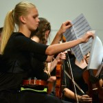 The freshman orchestra player, gets ready for the first song of the concert. Photo by Morgan Plunkett