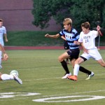Senior Grant Rosener tries to fight off his opponent as they both run to get the ball. Photo by Katherine Odell