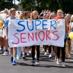 The senior class, dressed in array of superhero cosumes, begins to cross the senior lot to Mission. Photo by Kaitlyn Stratman