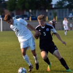Senior Oliver Bihuniak guards his opponent from Olathe Northwest while keeping possesion of the ball. Photo by Katherine Odell