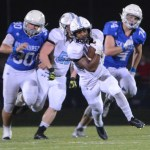 Senior Nigil Houston outruns the Rockhurst defensive line. Photo by Carson Holtgraves