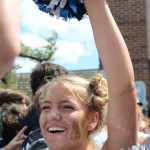 Sophomore Gracie Kost waves her poms and chants at the pep rally in Lancer Village. Photo by Ellen Swanson