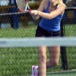 Junior Kirsten Erickson finishes a back hand cross court hit. Photo by Ellen Swanson