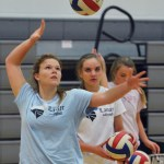 Sophomore Andie McConnell practices spiking the ball to her teammates. Photo by Libby Wilson