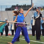 "Sophomore Megan Walstrom dances to music from ""Aladdin,"" played by the marching band at halftime. Photo by Libby Wilson"
