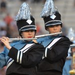 """Senior Greta Miller and freshman Ari Sharman play flute in the marching band's halftime performance of songs from """"Aladdin."""" Photo by Libby Wilson"""