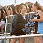 Sophomores Caylen Yé and Sofia Savic laugh while the student section cheers. Photo by Morgan Browning
