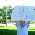 Junior Kirsten Erickson advertises the bake sale on Mission road. Photo by Maddie Smiley