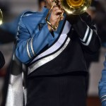 Senior Jack Barickman plays the school song on trombone during halftime. Photo by Audrey Kesler
