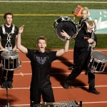 Senior Ian Longan hypes up the crowd during  a drumline performance. Photo by Allison Stockwell