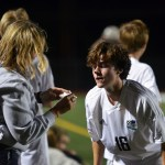 Shawnee Mission East's athletic trainer Megan Burki helps senior Will Krebs with his bloody nose after he collided with a player from Blue Valley North. Photo by Katherine Odell