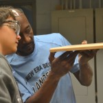 Mr.Scott and his student look at the smoothness of his cutting board.Photo by Morgan Plunkett