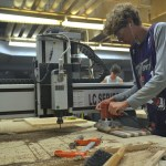 Freshman Peter Kohring works on his cutting board. Photo by Morgan Plunkett