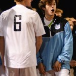 Senior Will Krebs watches the game while Shawnee Mission East scores and ties the game 2-2. Photo by Carson Holtgraves