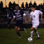 Senior Oliver Bihuniak runs down the field, in control of the ball. Photo by Kaitlyn Stratman