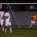 Junior keeper, Collyn Lowry, lunges to stop the penalty kick. Photo by Kaitlyn Stratman