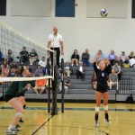 Senior Ally Offerdahl sets the ball for her teammates to spike the ball to the opposing team. Photo by Katherine Odell