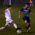 Senior Oliver Bihuniak uses his his technique to keep the ball from his opponent. Photo by Kaitlyn Stratman
