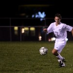 Junior Jack Pritchard prepares to kick the ball up the field. Photo by Kaitlyn Stratman
