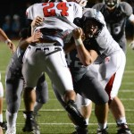 Senior Steven Shipley tackles the North offense player. Photo by Carson Holtgraves