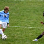 Freshman defender, Peter Kohring, dribbles around his opponent to then make a pass. Photo by Kaitlyn Stratman