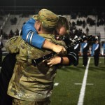 Senior Isabella Hayden was surprised by the appearance of her armed forces brother at the band senior night. Photo by Annie Lomshek