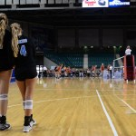 """After the game, Seniors Sarah Maddox and Ally Offerdahl stand together, watching the game on the court begin. """"This is our last time playing together"""" Offerdahl said to Maddox. Photo by Kaitlyn Stratman"""