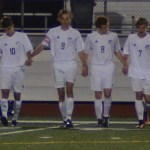 The whole team walks onto the field at the beginning of the game. Photo by Izzy Zanone