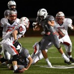 Sophomore Joseph Mohr gets tackled from behind. Photo by Morgan Browning