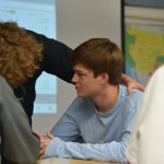 Sophomore Will Bruso talks to senior Peter McDonald about the small group discussion. Photo by Ava Simonsen