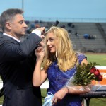 Senior Allie Libeer and her dad fix her crown after being named 2nd attendant. Photo by Maddie Smiley