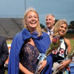 Senior Anna Dierks smiles at the crowd of parents and students after being crowned homecoming queen. Photo by Maddie Smiley