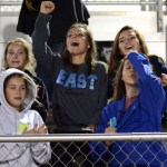 Freshmen Elli Tucker, Emme Tucker, Caroline Chisholm, Carolyn Popper, and Charlotte Brock cheer after the East wins the game. Photo by Ellie Thoma