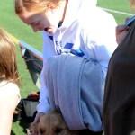 Sophomore Hazel Eastlack smiles as she pets her dog. Photo by Ellie Thoma