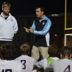 Coach Kelly talks to the team at halftime. Photo by Izzy Zanone