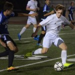 Junior Ian Schutt looks to play the ball forward to his fellow strikers. Photo by Audrey Kesler